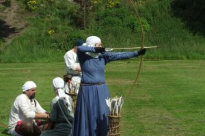 One of our members shoots with a longbow at a show.