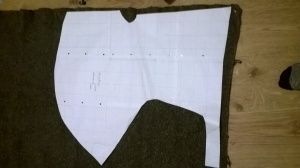 Fitting my pattern onto the dark grey wool twill, a charity shop bargain for this first experiment.
