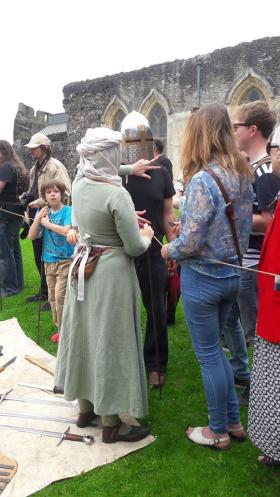 Group member demonstrating armour to the public