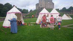 Garrison encampment with craft and armour and weapons displays