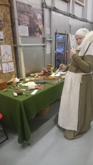 Spinning display with medieval craft display table