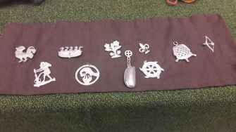 Replica pilgrims' badges; common medieval archaeological finds
